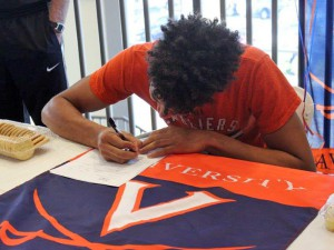 Wilkins, shown here signing his letter of intent with UVa last November