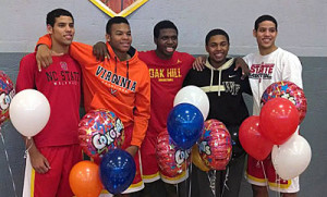 BJ Stith (in Virginia sweatshirt) at a signing ceremony at Oak Hill.