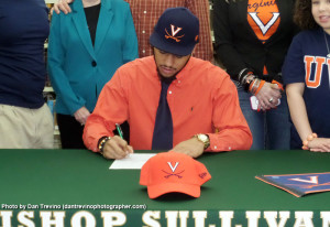 Kamara, shown here signing a letter of intent with UVa, is expected to play as a true freshman.