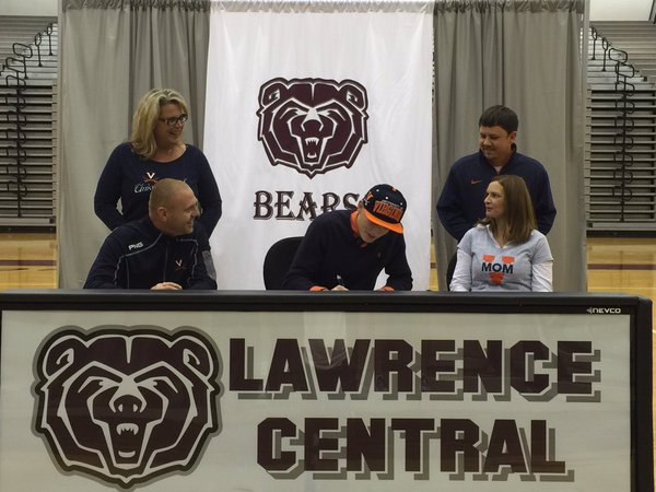 Guy signs his letter of intent with the Hoos