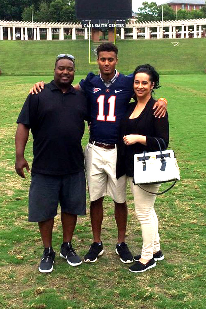 Jana, pictured here with his parents in Scott Stadium, had two big scores in Woodberry's season finale