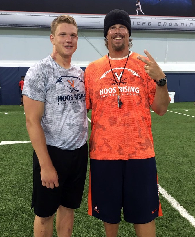 OL commit Crider, one of 10 prospects to commit to UVA this month, poses with UVA offensive line coach Garett Tujague
