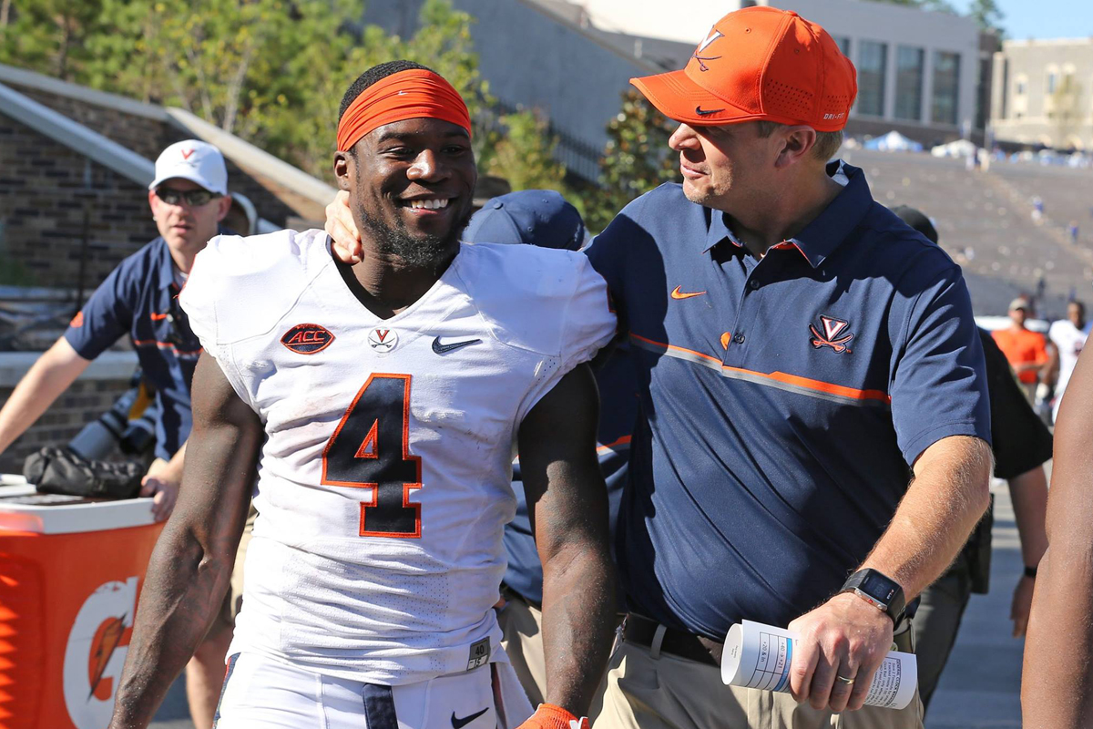 Bronco Mendenhall enjoys the Duke win with Taquan Mizzell.