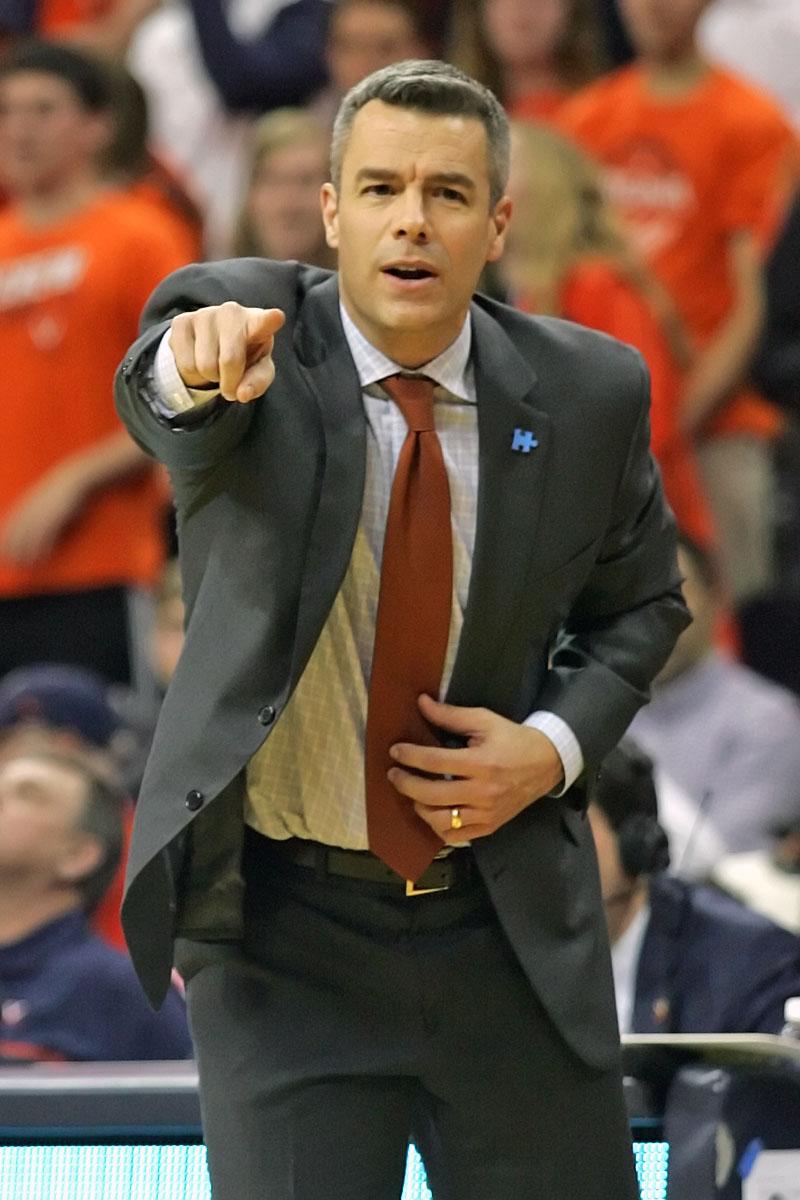 Virginia coach Tony Bennett has posted six straight seasons with a winning ACC record.
