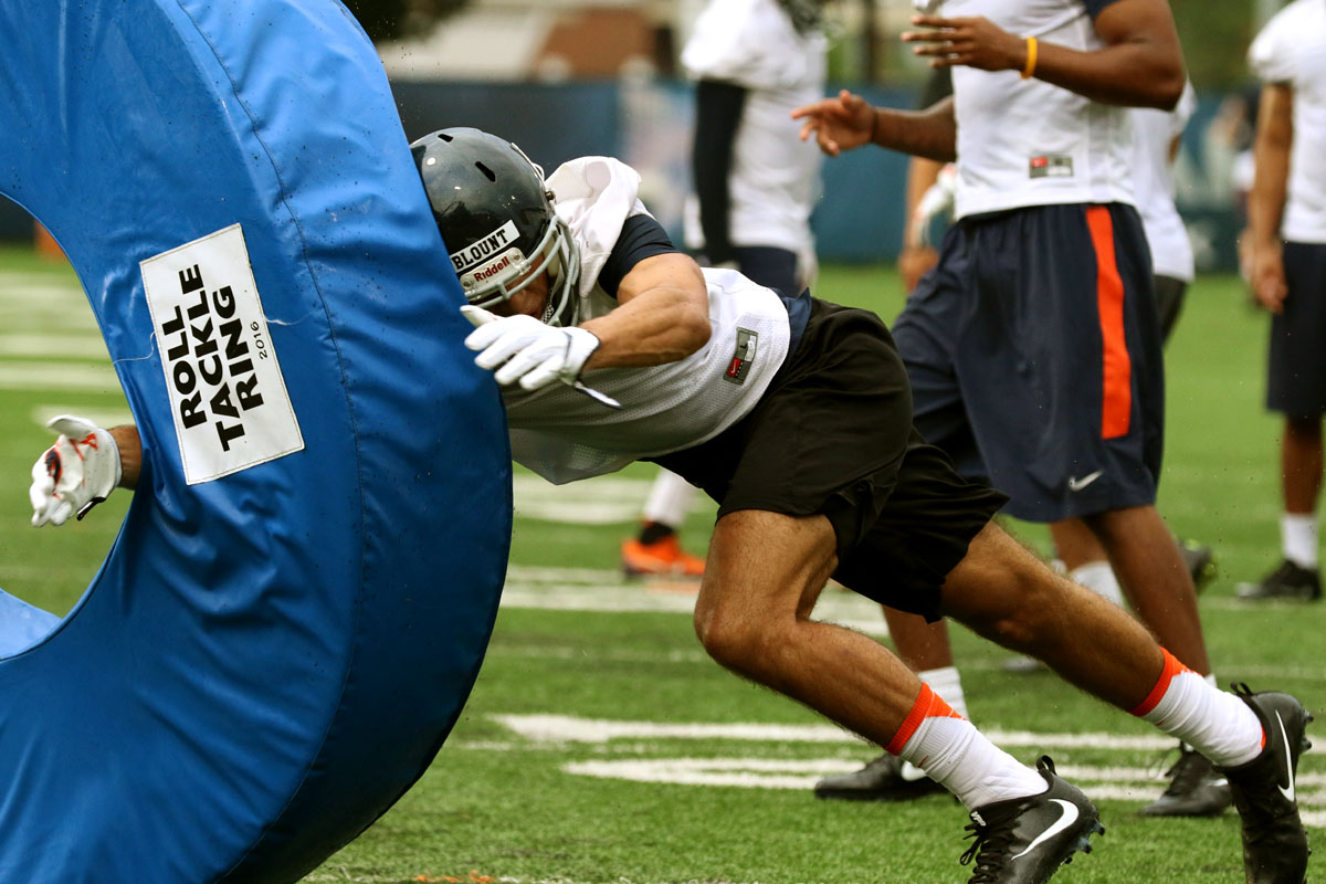 Virginia sophomore Joey Blount works on his tackling at a fall practice.