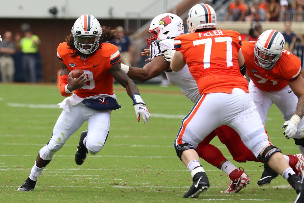 Virginia quarterback Bryce Perkins runs for yards.